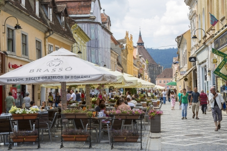 BRASOV, ROMANIA - JULY 26  Crowded cafes and people strolling down the Republic Street on July 26, 2013 in Brasov, Romania  Brasov is the 7th largest city and the most visited in Romania