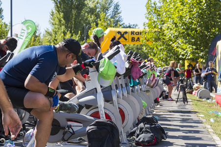 Group of people exercising on stationary bikes during a public cycling marathon on 15 09 2013 in Bucharest, Romania