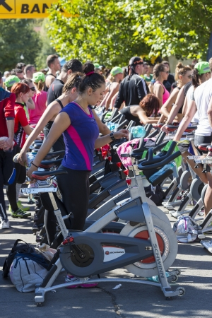 Group of people using stationary bicycles for cardio training during a public cycling marathon on stationary bikes on 15 09 2013 in Bucharest, Romania