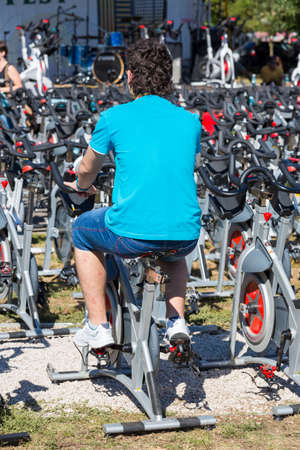 Unidentified young man doing cardio training during a public cycling event on 15 09 2013 in Bucharest, Romania