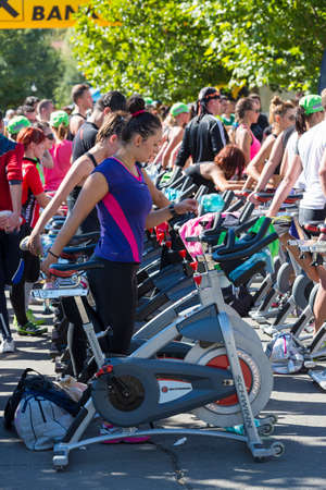 Group of people using stationary bicycles for cardio training during a public cycling marathon on stationary bikes on 15.09.2013 in Bucharest, Romania.