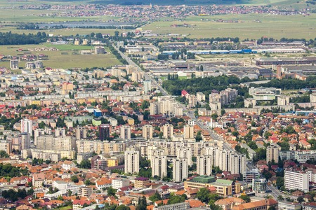 Wide aerial view of residential suburbs of Brasov city, Romania. photo