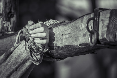 Nailed hand on wooden cross  Crucifixion of Jesus Chris  Black and white