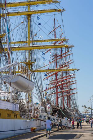 embark: CONSTANTA, ROMANIA - MAY 25: Unidentified tourists embark and visit the Romanian tall ship Mircea docked during Black Sea Tall Ships Regatta 2014 on May 25, 2014 in Constanta port, Romania.