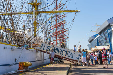 embark: CONSTANTA, ROMANIA - MAY 25: Unidentified people embark and visit the Romanian tall ship Mircea docked during Black Sea Tall Ships Regatta 2014 on May 25, 2014 in Constanta port, Romania.