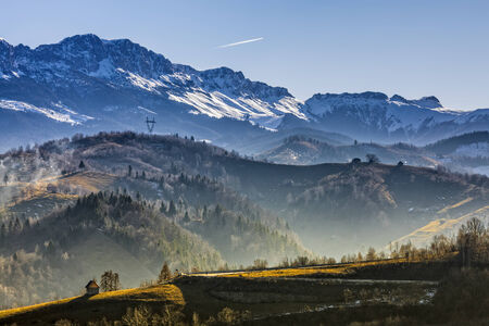 Sunny morning landscape in the valley of Bucegi mountains range, Brasov county, Romania. photo