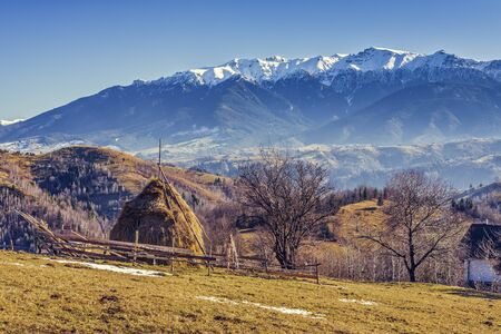sheepfold: Alpine rural landscape with sheepfold and haystack in the valleys of Bucegi mountains, Brasov county, Romania.