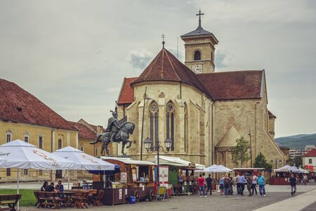 saint michael: ALBA IULIA, ROMANIA - MAY 6, 2015: Unidentified tourists visit the Saint Michael Roman Catholic cathedral, the oldest and the longest cathedral in Romania (89.16 m along its axis).
