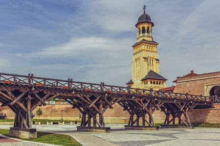 coronation: ALBA IULIA, ROMANIA - MAY 6, 2015: The Coronation Orthodox Cathedral tower and Alba Carolina Fortress. The fortress is considered to be the most representative of Vauban type fortification in Europe.