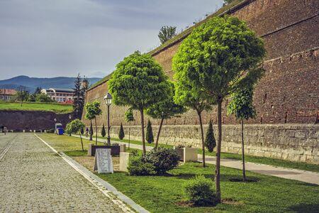 perimeter: ALBA IULIA, ROMANIA - MAY 6, 2015: The fortification walls (about 12 km in perimeter) and promenades of the bulwark fortress of Alba Iulia, built between 1715 and 1738.