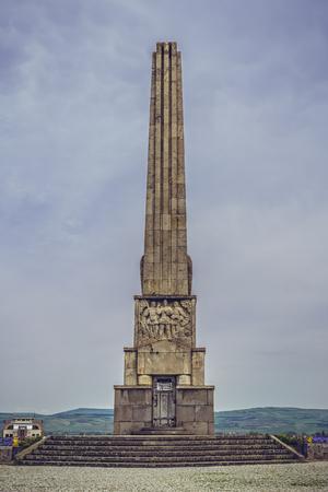 uprising: ALBA IULIA, ROMANIA - MAY 6, 2015: The 20 m tall granite Obelisk in White Carolina citadel, erected in 1937 in the memory of Horea, Closca and Crisan, the leaders of the 1784 uprising of the peasants. Editorial