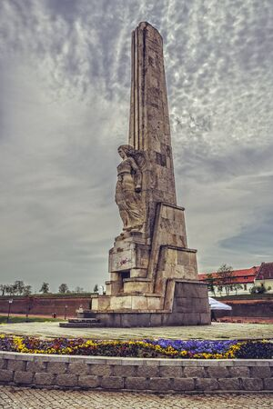 revolt: ALBA IULIA, ROMANIA - MAY 6, 2015: The granite obelisk dedicated to the memory of the 1784 peasant revolt leaders, Horea, Closca and Crisan, built in 1937, in front of the third gate of the fortress. Editorial