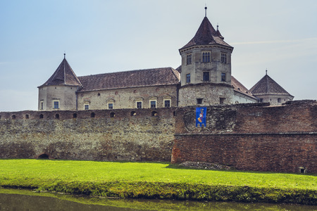 10 best: FAGARAS, ROMANIA - JUNE 4, 2015: Fagaras fortress, built around 1310, one of the largest and best preserved feudal castles in Eastern Europe, ranks 2nd in the top 10 best castles in the world.