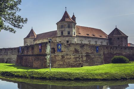 feudal: FAGARAS, ROMANIA - JUNE 4, 2015: Fagaras fortress, built around 1310, one of the largest and best preserved feudal castles in Eastern Europe, ranks 2nd in the top 10 best castles in the world.