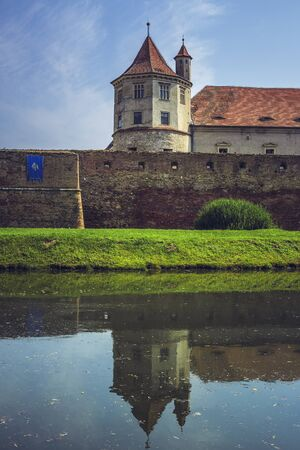 feudal: FAGARAS, ROMANIA - JUNE 4, 2015: Fagaras fortress, built around 1310, situated right in the heart of central Romania, represents one of the largest and best preserved feudal castles in Eastern Europe.
