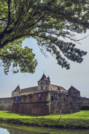 fagaras: FAGARAS, ROMANIA - JUNE 4, 2015: Fagaras fortress, built around 1310, one of the largest and best preserved feudal castles in Eastern Europe, ranks 2nd in the top 10 best castles in the world.