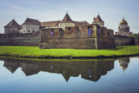 feudal: FAGARAS, ROMANIA - JUNE 4, 2015: Fagaras fortress, built around 1310, one of the largest and best preserved feudal castles in Eastern Europe, ranked 2nd in the top 10 best castles in the world.