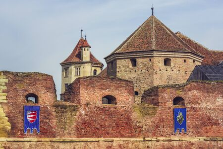 feudal: FAGARAS, ROMANIA - MAY 6, 2015: The fortification walls and towers of the Fagaras fortress, built around 1310, one of the largest and best preserved feudal castles in Eastern Europe. Editorial