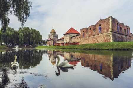 vestige: FAGARAS, ROMANIA - JUNE 4, 2015: Fagaras fortress, built around 1310, surrounded by a wide defensive ditch filled with water, one of the largest and best preserved feudal castles in Eastern Europe. Editorial