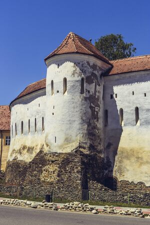 vestige: PREJMER, BRASOV, ROMANIA - JUNE 8, 2015: Prejmer fortified church, the largest in southeastern Europe, built by Teutonic knights in 1212-1213, with defense walls of 40 feet high and 10-15 feet thick.