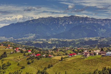 locality: Rural landscape with traditional Romanian mountainous village nearf the Bucegi mountains range, in Pestera locality, Brasov county, Romania.