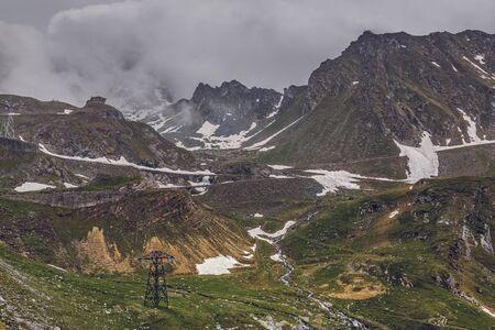 wintery: Overcast wintery mountain landscape with Transfagarasan road in Fagaras mountains, Romania.