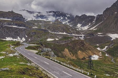Winter mountain landscape with famous winding Transfagarasan road in Fagaras mountains, Romania.