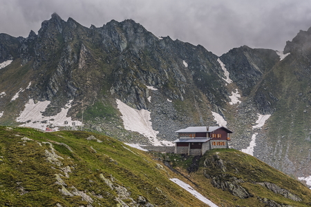 balea: Mountain scenery with cottage at Balea lake resort in Fagaras mountains, Romania. Stock Photo