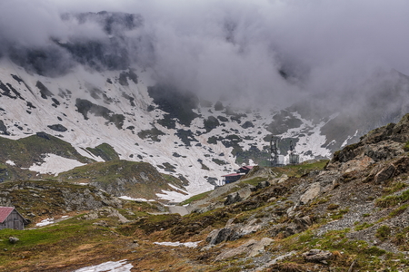 balea: Gloomy mountain landscape at Balea Lake resort in Fagaras mountains, Romania. Stock Photo