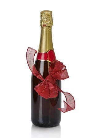 sektglas: Jahrestag Champagnerflasche verknotet mit rot auf wei�em beugen.
