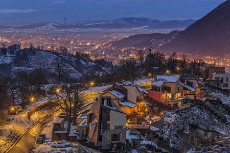 brasov: Night wintry cityscape with city lights of Brasov city, Romania.