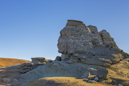 resemblance: The Sphinx (Sfinxul) natural rock formation over clear blue sky in Bucegi Mountains, Romania. Stock Photo
