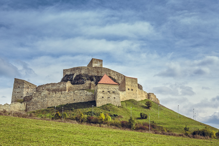 vestige: Rupea, Romania - October 10, 2015: Old medieval Rupea fortress, first attested in 1324, is one of the oldest archaeological sites in Romania, visited each month by more than 10,000 tourists.