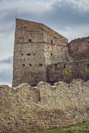 archaeological sites: Rupea, Romania - October 10, 2015: Fortification walls of the medieval Rupea citadel, first attested in 1324, one of the oldest archaeological sites in Romania. Editorial