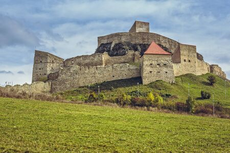 attested: Rupea, Romania - October 10, 2015: Old medieval Rupea fortress, first attested in 1324, is one of the oldest archaeological sites in Romania, visited each month by more than 10,000 tourists.