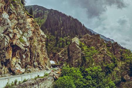 transfagarasan: Mountain scenery with Transfagarasan road winding along high rocky cliffs at high altitude in Fagaras mountains, Romania. Stock Photo