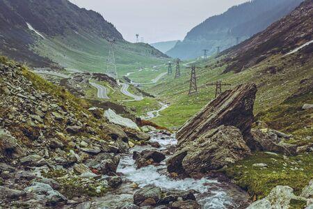 transfagarasan: Scenic vista with meandering fresh water stream rapids flowing along the famous sinuous Transfagarasan road in Fagaras mountains, Romania.