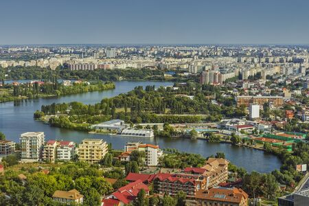 apartment blocks: Bucharest, Romania - August 16, 2013: Picturesque aerial view of the Tei Lake (Linden Tree Lake) and its neighborhood in the Bucharest Northern Side.