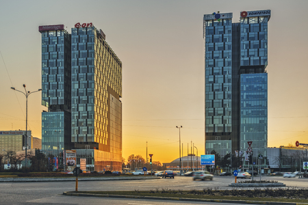 parking spaces: Bucharest, Romania - March 03, 2013: City Gate Towers at sunset, two class A 18 floor office buildings with a surface of 36,000 m2 18,000 m2 each, 1 000 parking spaces.