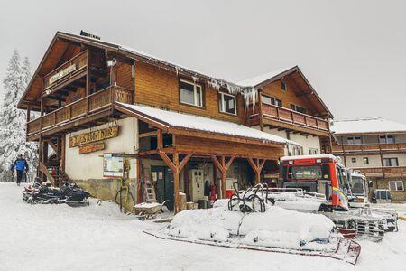 ski lodge: Poiana Brasov, Romania - February 5, 2016: Postavaru chalet and snow covered snowplow tractor, at 1604m altitude in Postavaru mountain, Poiana Brasov winter resort, Brasov county. Editorial