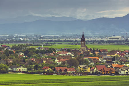 commune: Rural scenery with the steeple of the fortified German church in Sanpetru village, a commune located at 5 km north of Brasov city, in Transylvania region, Romania,