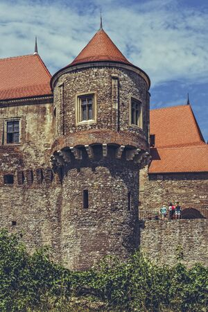 historians: Hunedoara, Romania - July 23, 2016: The Drummers Tower of the Corvin Castle. According to historians, from this tower, the castle drummer used to announce the locals to come to pay their taxes.