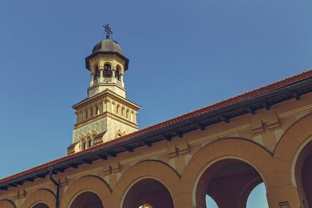 Alba Iulia, Romania - July 24, 2016: Low angle view of the Coronation Orthodox Cathedral steeple, dedicated to the Holy Trinity and Holy Archangels Michael and Gabriel, built between 1921-1922. Editorial