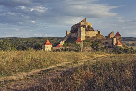 Rupea, Romania - July 21, 2016: Medieval Rupea citadel, first attested in 1324, is one of the oldest archaeological sites in Romania and is visited each month by more than 10,000 tourists.