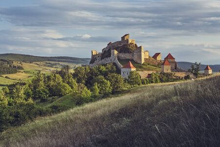 Rupea, Romania - July 21, 2016: Medieval Rupea fotress, first attested in 1324, is one of the oldest archaeological sites in Romania and is visited each month by more than 10,000 tourists.