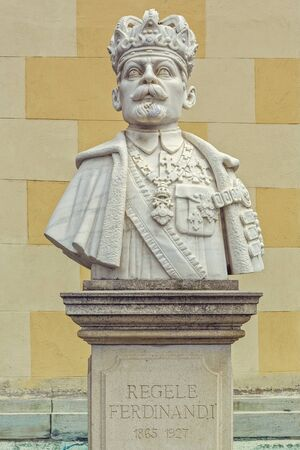 ferdinand: Alba Iulia, Romania - July 24, 2016: Imposing marble bust sculpture of King Ferdinand I of Romania placed in front of the Coronation Orthodox Cathedral in the Alba Iulia Fortress.