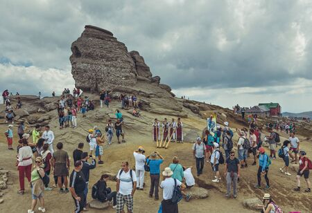 Bucegi Mountains, Romania - August 6, 2016: Thousands of tourists come to visit the Sphinx, the mythical megalith with human face resemblance located at 2,216 m altitude on Bucegi Mountains plateau.
