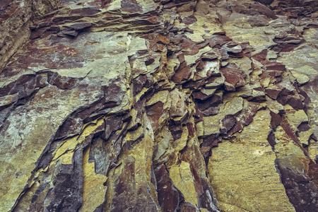 strata: Ferruginous rock strata closeup. Rock layers background.