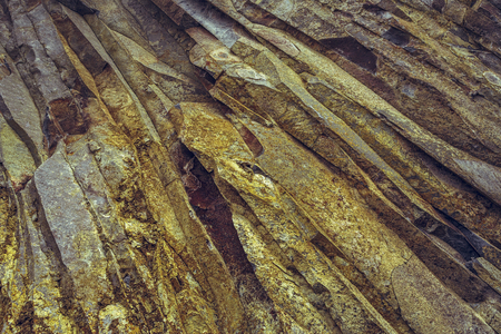 Close view of rock layers in a basalt pit. Rock texture.