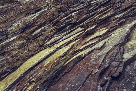 strata: Ferric rock strata closeup. Rusty rock pattern.
